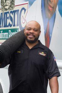 Route Sales Representative delivering mats